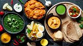 Indian Cuisine Dishes: Tikka Masala, Dal, Paneer, Samosa, Chapati, Chutney, Spices. Indian Food On D poster