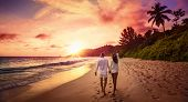 Young Happy Lovers on Beach. Couple Walking on Romantic Travel Honeymoon Vacation Summe Holidays Rom poster