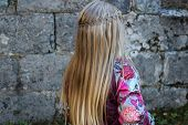 A Girl With Braided Hairstyle. Waterfall Braid In Long Hair. poster