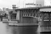 Portland's Burnside bridge over the Williamette River on a hazy day in black and white