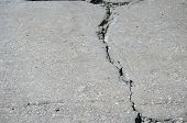 Crack In Concrete Slab Of Coastal Promenade As Result Of Sea Water Erosion poster