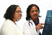 picture of mixed race  - Minority doctor set on white background talking with patient - JPG