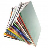 Pile of colorful magazines isolated over white background