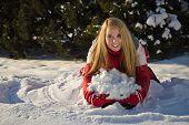 Woman Building A Snow Pile