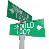 A green two-way street sign pointing to Should I stay or Should I Go with arrows pointing to left or