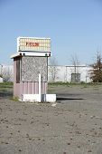 stock photo of matinee  - An old drive in movie ticket booth with a blank sign for your text - JPG