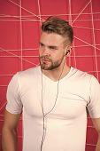 Man Unshaven Bearded Stylish Hairstyle Listen Music Or Motivating Speech Earphones. Listen Music Rad poster
