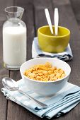 Bowl Of Cereal With Milk On Rustic Table