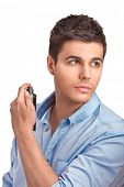 A handsome young man using perfume isolated on white background