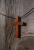 Cross Necklace On Wood Fence