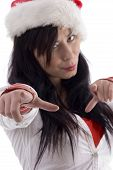 Attractive Woman Pointing With Finger And Wearing Christmas Hat