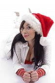 Sexy Woman Posing In Front Of Camera And Wearing Christmas Hat