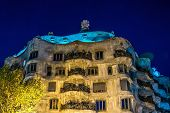 BARCELONA - NOVEMBER 24: Antonio Gaudi's famous Casa Mila, also known as La Pedrera , illuminated at night,  on November 24, 2012 in Barcelona, Spain