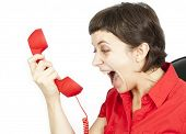 Businesswoman  screaming into a phone