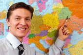 Businessman Pointing On The Map