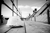 stock photo of scaffold  - empty building site with left helmet on scaffold - JPG