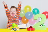 Adorable little boy celebrating second birthday
