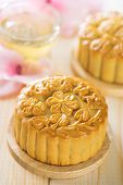 Chinese mid autumn festival foods. Traditional mooncakes on table setting with flower tea.  The Chin