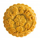 Traditional mooncake isolated on white background. Chinese mid autumn festival foods. The Chinese words on the mooncake means assorted fruits nuts, not a logo or trademark.