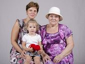 Family portrait of the child, grandmother and great-grandmother
