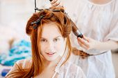 picture of hair comb  - Hair stylist makes the bride before the wedding - JPG