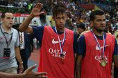 KUALA LUMPUR - AUGUST 10: FC Barcelona's Neymar and Dani Alves walk with the championship medal at the Shah Alam Stadium on August 10, 2013 in Kuala Lumpur, Malaysia defeating Malaysia 3-1.