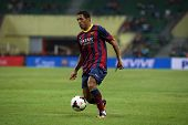 KUALA LUMPUR - AUGUST 10: FC Barcelona's Adriano (maroon/blue) dribbles the ball in a friendly match