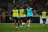KUALA LUMPUR - AUGUST 9: FC Barcelona 's Lionel Messi (blue bib) practices during training at the Bu