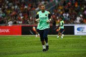 KUALA LUMPUR - AUGUST 9: FC Barcelona goal keeper Victor Valdes jogs during training at the Bukit Jalil National Stadium on August 09, 2013 in Malaysia. FC Barcelona is on an Asia Tour to Malaysia.