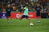 KUALA LUMPUR - AUGUST 9: FC Barcelona's Neymar Jr kicks the ball during training at the Bukit Jalil