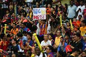 KUALA LUMPUR - AUGUST 9: FC Barcelona fans fill the stadium during Barcelona's training at the Bukit Jalil National Stadium on August 09, 2013 in Malaysia. FC Barcelona is on an Asia Tour to Malaysia.
