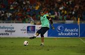 KUALA LUMPUR - AUGUST 9: Barcelona goalkeeper Jose Manuel Pinto clears the ball at training at the Bukit Jalil Stadium on August 09, 2013 in Malaysia. FC Barcelona is on an Asia Tour to Malaysia.