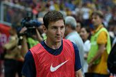 KUALA LUMPUR - AUGUST 10: FC Barcelona 's Lionel Messi walks to the field before the match starts ag