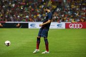KUALA LUMPUR - AUGUST 10: FC Barcelona 's Gerard Pique kicks the ball during warm-up before the game