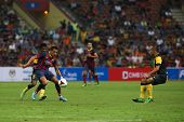 KUALA LUMPUR - AUGUST 10: FC Barcelona's Alexis Sanchez (maroon/blue) controls the midfield in a gam