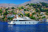 Greece - pictorial island Symi bay with white yacht