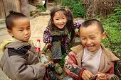 Three Chinese Children Having Fun Near The Farmhouse, Basha Miao Village, Congjiang County, Southeas