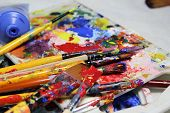 pic of bute  - Art palette with a lot of paints and paintbrushes - JPG