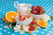 Healthy Breakfast. Rolled Oats, Strawberries And Oranges In A Beautiful Tablecloth