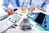picture of accounting  - Hand with calculator - JPG