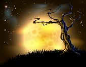 stock photo of spooky  - A spooky scary orange Halloween background scene with full moon clouds hill and scary tree - JPG