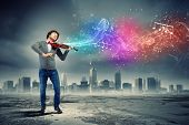 stock photo of cello  - Image of young handsome man playing violin - JPG