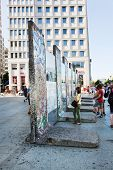 BERLIN - July 23: Parts of Berlin Wall on Potsdamer Platz with chewing gums stuck to it on July 23, 2013 in Berlin. Tourists can admire original parts of Berliner Mauer