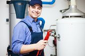picture of pipefitter  - Portrait of a smiling plumber at work - JPG