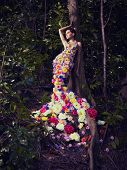 image of jungle flowers  - Blooming gorgeous lady in a dress of flowers in the rainforest - JPG
