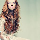 foto of redhead  - A portrait of stylish elegant redheaded girl is in lace clothes - JPG