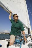 Man looking away while sailing boat