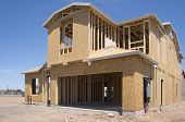 stock photo of 2x4  - New home under construction wood frame - JPG