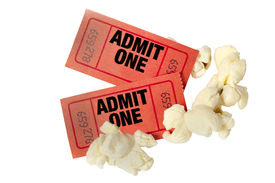 foto of matinee  - Close up shot of two red movie tickets with scattered popcorn - JPG