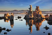 Outliers -  bizarre calcareous tufa formation  reflected in the mirrored surface of the water. The